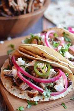Crock Pot Carnitas Tacos with Chipotle Cream. Super crispy & juicy with no lard! Easy to make in the crock pot, & my boyfriend can't get enough of them!
