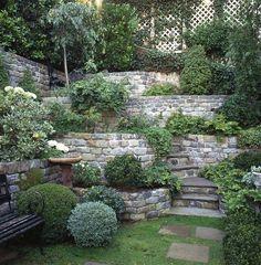 Love this tiered #stone #retainingwall - multi-level landscaping!   Everdell Garden Design 마당에서 태양광쪽 단면설계..