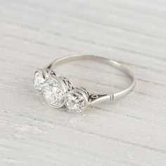 Vintage Art Deco .75 Carat Three Stone by ErstwhileJewelry on Etsy, $4500.00