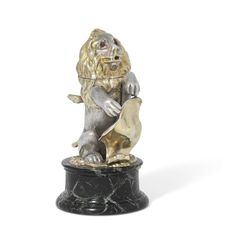 In the form of a lion rampant supporting a rococo shield, the hinged head with red and black glass eyes, with frosted glass liner, the inkpot cover pierced with foliage, mounted on a green marble base, marked on base, in cover and on inkpot cover 71⁄4 in. (18cm.) high Green Marble, Special Characters, Rococo, Black Glass, Frosted Glass, The Collector, Lion Sculpture, Auction, Victorian