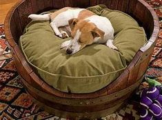 Treat you dog with a wine barrel dog bed. We hand make these, sand them flush and ship daily. This item is unstained and has a natural wood look ( Light tanish in color) from the French Oak. Very nice. $59 per dog bed. The pillow in a similar style can be added for $39. To order the
