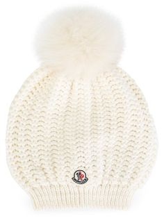 ad821f59a20ed Shop Moncler cable knit bobble hat in Feathers from the world s best  independent boutiques at farfetch.com. Shop 400 boutiques at one address.