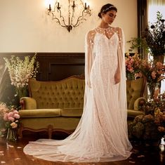 e699e921ddf This petal Melissa Sweet wedding dress is elevated when paired with this  romantic wedding dress cape. David s Bridal