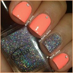 coral nails with rhinestone accent