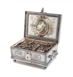 A Spanish Steel Sewing Case, CIRCA 1800, comprising two needle cases, a scissor, two spools, two star form winders, a bodkin and other tools...