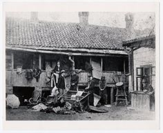 Kishinev, 1903 - Victims of the pogrom pose outside their ruined home.