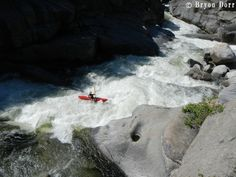 Laura Ferrell dropping into the Gorge Rapids on Dinkey Creek. She rocked it as she was chasing Lars's paddle and boat.