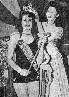 """Original Caption:  """"SHE CAN SING, TOO - Even in wartime, that lucky little group of fellows got together in Atlantic City last month, looked over America's lovliest gals, and chose Jo Carroll Dennison, a flashing-eyed beauty from Tyler, Texas, as Miss America 1942. The judges said they also like Jo's rendition of """"Deep in the Heart of Texas."""" Frances Burke, Miss America 1940, does the crowning."""" (CBI Roundup, Vol. I, No. 7, Delhi, Thursday, October 29, 1942)"""