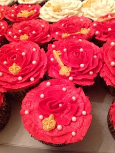 Flower cupcakes with vanilla cake and vanilla buttercream lighter red color