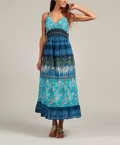 Show off sun-kissed shoulders with this fabulous frock! A bold print combines with delicate straps to create a standout style, while the surplice neckline provides a flattering look.