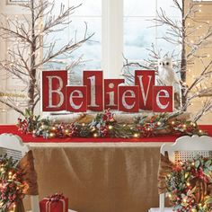"""Believe Blocks. Individual wood blocks for ea letter ranging from 7""""-11"""", red background with subtle snowflake design, white letters. Great for mantel or tabletop."""