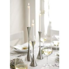 "Arden Mirrored Stainless Steel Taper Candle Holders Designed by UK designer Robert Welch | Crate and Barrel / L 13.5""x 3""Dia / M 11.5""x 3""Dia/ S 9.5""x 3""Dia / $59.95,54.95, 49.95"