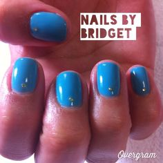 Blue with a simple gold gem on each nail