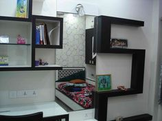 kids bedroom with shelves design by Arpita Doshi, Architect in Kolkata, West Bengal, India.