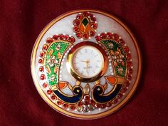 Marble golden painted artifact is jeweled with meenakari & kundan work is a worthy acquisition & perfect gift  for all occasion.www.rusticaa.com