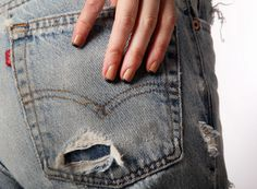 The iconic Levi's back pocket and little red tag can often lead to clues about the age and value of old Levis. Some sell for thousands of dollars. Mary also likes to experiment with her nail art. She gets them done at Diamond Nails on Madison in Lakewood. (Allison Carey/The Plain Dealer).