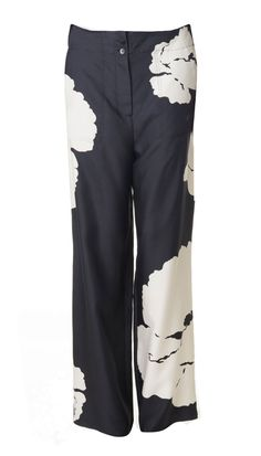 Blurring the boundaries of comfort and style, the pajama trend made a splash this season. Fitting the trend, these bootcut silk trousers feature bold blooms on soft silk. Keep the pants in focus with a plain tee and flat sandals. Flat front closure. Unlined.    Styled with Stretch Kate Sleeveless Bodysuit and Mela Sandals  100% Silk Twill  Style Number: TS116AMA34247  Available in: Black