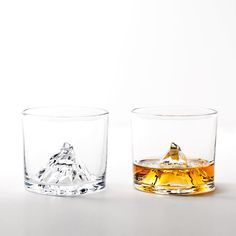 A whole new way to reach the summit.  Swiss Alps Matterhorn Glasses $45 for a set of 2 at Cool Material Shop.