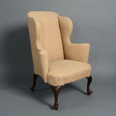 Timothy Langston   An Early 18th Century George I Walnut Wing Armchair  Winged Armchair, English