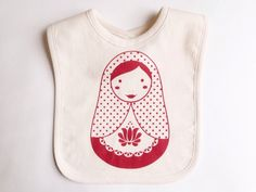 "Screen Printed ""Babushka"" Organic Baby Bib/ Red/ Onesie/ Newborn/ Baby Essentials/ Necessities/ Baby Shower Gift/ Nesting Doll/ Layette by JumpingBirds on Etsy https://www.etsy.com/listing/168202255/screen-printed-babushka-organic-baby-bib"