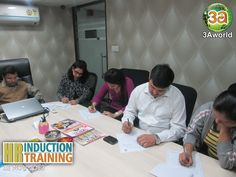 Participants filling the Induction form and sharing their views about the HR Induction & Training Workshop.