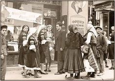 Bulgarian women from Bosilegrad District in Kyustendil style costumes shopping in Belgrade. Wow! Look at those opanci.