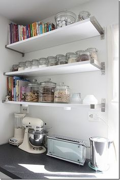 line of jars on open, kitchen shelves - could paint the front with a square of chalkboard paint and then label what's in them...