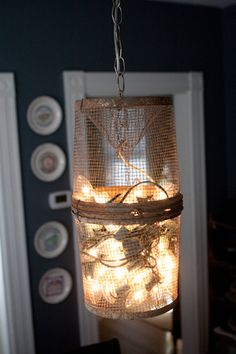 New use for fishing basket; repurposed as a light by Katherine Jane.