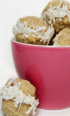 Two super yummy coconut cookies with a rich vanilla butter cream frosting center rolled in coconut!