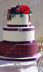 Replicated in your tartan, perhaps with sage green ribbon. Middle tier embossed with a lace pattern?  Google Image Result for http://romeoandjulietcakes.com/communities/9/004/009/952/469/images/4575902862_pre.jpg