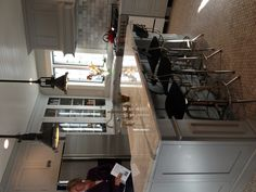 Love this island with gray marble, industrial lighting by Restoration Hardware.  Kitchen Tour North Shore Boston.