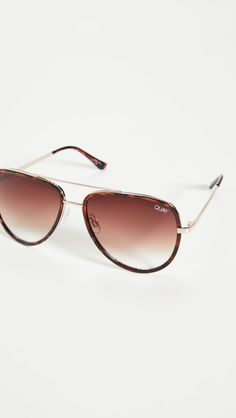Tortoiseshell frames with gold-tone bridge Soft case included Aviator frame Non-polarized lenses Imported, China Metal frame Gradient lenses Measurements Width: / Height: / Lens Width: 70s Sunglasses, Types Of Sunglasses, Summer Sunglasses, Mirrored Sunglasses, Sunnies, Guard Your Eyes, Selena Gomez 2019, Jessica Alba Casual, White Top And Jeans