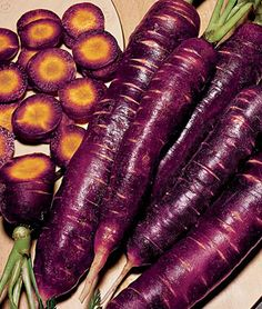 Purple dragon carrot  Slice it, shred it, love it. This gloriously sweet carrot is the richest, most intense purple. We love to make a cool summer carrot salad of yellow, orange and purple varieties, delicious and a treat for the eyes. Carrot aficionados (and who isn't) will delight in this unique, yet tasty, variety with its purple skin and light yellow core.    burpee.com