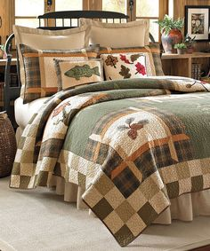Add a touch of nature-inspired appeal to your bedroom with this cozy quilt boasting classic patchwork and woodland designs.