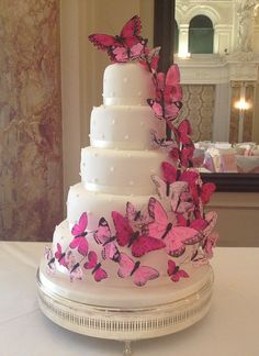 What a unique wedding cake with butterflys