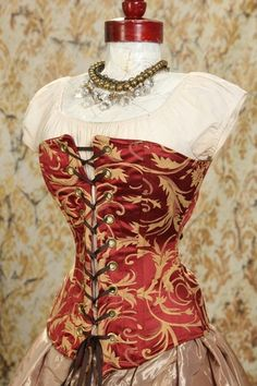 Red with Gold Swirl Over Bust Corset by Damsel in this Dress