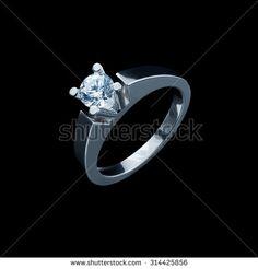 close up of diamond ring on black background
