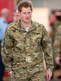 Prince Harry, who was recently recognized for his apache copilot skills, pays a visit Friday to England's Royal Air Force Base Honington, where the young royal shared stories with local troops and toured the facilities.