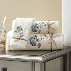 The three sizes of coordinating towels are each embroidered with f...