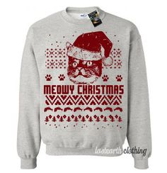 We wish you a Meowy Christmas. Graphic will be hand screen printed on a super soft and comfortable fleece pullover sweatshirt. We use only water based screen-printing inks that contain no harmful chem