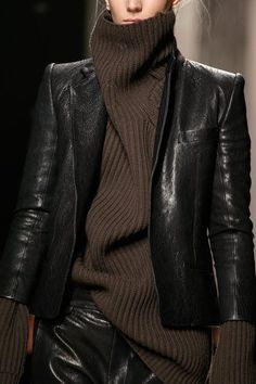 Fashion, New York City Style. Extra long sleeves on this chocolate cable knit sweater, with a leather blazer.