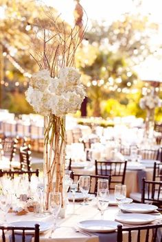 The altar will be flanked by two large arrangements of birch branches and blush hydrangea