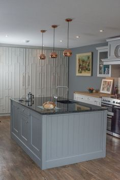 The Shere Kitchen Collection A mix of solid Shaker-style cabinetry with elegantly patterned floor to ceiling larder units.  Handmade fine furniture - made by craftsmen in the Surrey Hills.