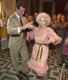 Getting down: The Duchess of Alba dances with her son Cayetano Martinez de Irujo at the wedding reception for her third marriage to Alfonso Diez Carabantes in October 2011