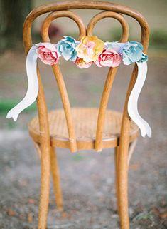 Paper Flower Wedding Chair Decor | Paige Reaux Photography | See More: http://heyweddinglady.com/love-bloom-gorgeous-paper-flower-ideas-wedding/