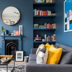 Dark blue walls by Farrow & Ball, lifted with yellow velvet cushions and alcove . - Dark blue walls by Farrow & Ball, lifted with yellow velvet cushions and alcove shelving housing a - Living Room Decor Elegant, Living Room White, Living Room Paint, New Living Room, Living Room Modern, Living Room Designs, Blue Feature Wall Living Room, Dark Blue Walls, Living Room Shelves