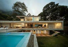 Studio Arthur Casas have designed Casa AL, located in the hills near Rio de Janeiro, Brazil.