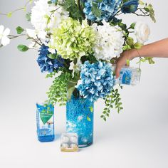This arrangement is light and fresh with hues of blues inspired by the coastal waters around the world