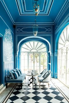 The palatialBar Palladioin Jaipur, India designed by Marie-Anne Oudejans. The sprawling azure grounds are a master class in monochromatic chic.