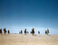 Capa: TUNISIA. 1943. The French Camel Corps, the Meharists, ride through the desert to head for battle. When they attack, the Meharists leave their camels two miles in the rear and creep up on foot.